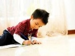 boy toddler on floor drawing